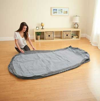 girl unfolding air mattress