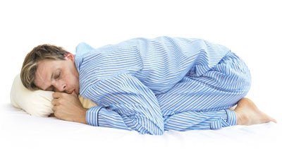 man sleeping in baby position