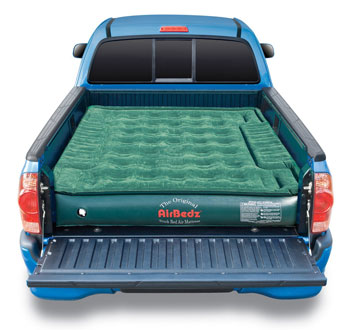 Green truck bed air mattress on a blue truck