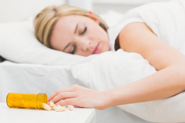 young girl deep asleep melatonin pills spilled on table