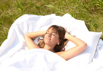 relaxed woman sleeping outside