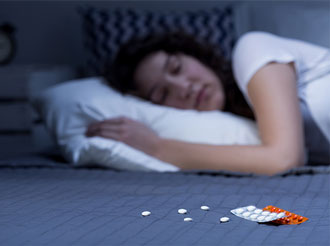 woman sleeping valerian root-and-melatonin on mattress close up