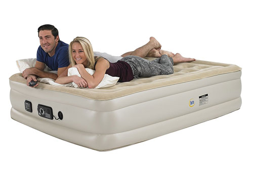 couple lying on twin air mattress