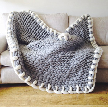 knitted blanket on sofa