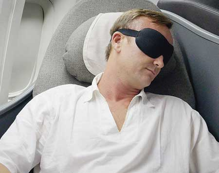 man wearing nidra mask on travel
