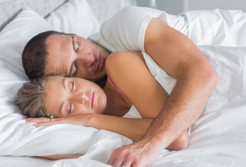 couple sleeping in spoon position