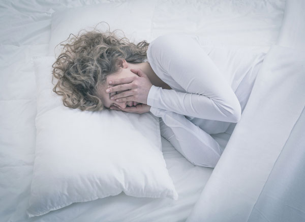 woman alone in bed restless
