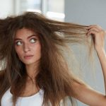 woman with damaged long hair after sleeping