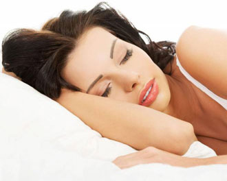 young woman sleeping with wet hair